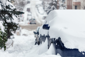 Cars and roads covered with snow