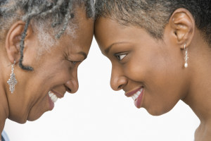 Close up profile of mother and daughter looking at each other